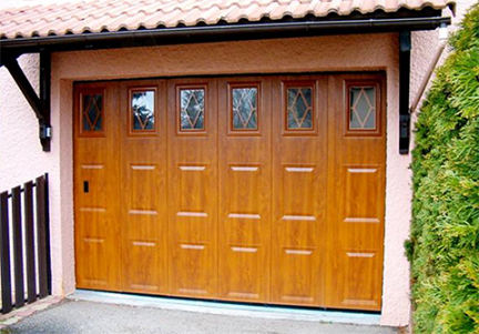 Side sliding garage door with wood windows panes and portholes